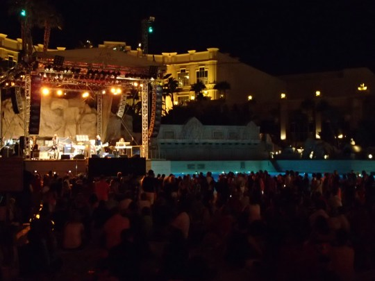 Concert goers at The Beach at Mandalay Bay Vegas, can either sit on the sand or wade into the wave pool to be closer to the act.