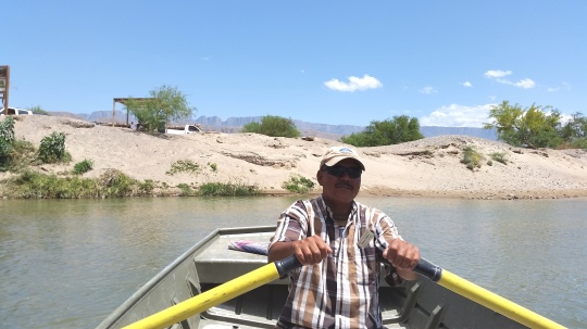 Mexican rower across the Rio Grande. (c) RVLuckyOrWhat.com